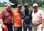 Orange and Black Ball Winner Golfs with Coach Stoudamire